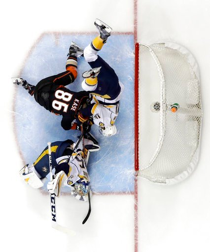 (AP Photo/Chris Carlson). Nashville Predators' Mattias Ekholm (14) collides with Anaheim Ducks' Ondrej Kase (86) as they battle for the puck by the goal during the first period of Game 2 of the Western Conference final in the NHL hockey Stanley Cup pla...