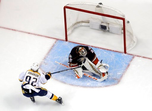 (AP Photo/Chris Carlson). Nashville Predators center Ryan Johansen scores past Anaheim Ducks goalie John Gibson during the first period of Game 2 of the Western Conference final in the NHL hockey Stanley Cup playoffs, Sunday, May 14, 2017, in Anaheim, ...