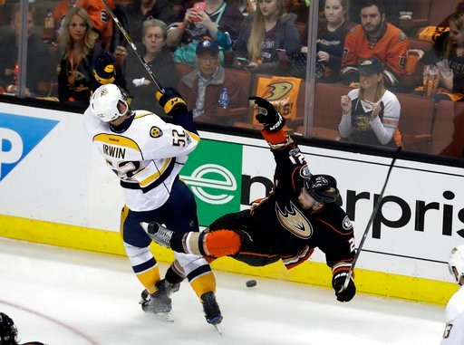 (AP Photo/Chris Carlson). Nashville Predators' Matt Irwin (52) collides with Anaheim Ducks' Chris Wagner (21) as they battle for the puck during the second period of Game 2 of the Western Conference final in the NHL hockey Stanley Cup playoffs, Sunday,...