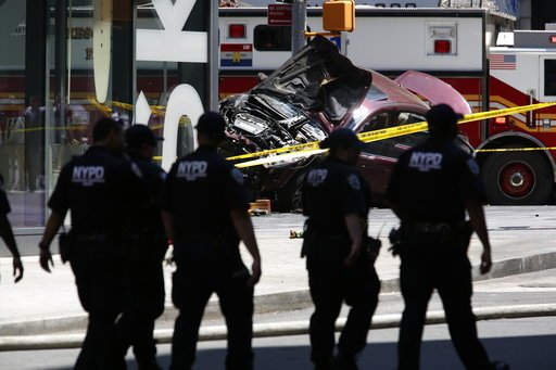 (AP Photo/Seth Wenig). A smashed car sits on the corner of Broadway and 45th Street in New York's Times Square after ploughing through a crowd of pedestrians at lunchtime on Thursday, May 18, 2017. Police do not suspect a link to terrorism and the driv...