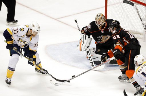 Nashville Predators center Colin Wilson scores against Anaheim Ducks goalie Jonathan Bernier during the second period of Game 5 in the NHL hockey Stanley Cup Western Conference finals in Anaheim Calif. Saturday May 20