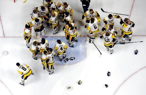 (AP Photo/Mark Humphrey). Pittsburgh Penguins players celebrate after defeating the Nashville Predators in Game 6 of the NHL hockey Stanley Cup Final, Sunday, June 11, 2017, in Nashville, Tenn.