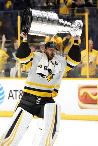 (AP Photo/Mark Humphrey). Pittsburgh Penguins' Matt Murray (30) celebrates with the Stanley Cup after defeating the Nashville Predators 2-0 in Game 6 of the NHL hockey Stanley Cup Final, Sunday, June 11, 2017, in Nashville, Tenn.