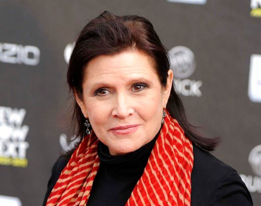 (AP Photo/Chris Pizzello, File). FILE - This April 7, 2011 file photo shows Carrie Fisher at the 2011 NewNowNext Awards in Los Angeles. A coroner's report released Monday, June 19, 2017, shows that Fisher had cocaine, ecstasy and heroin in her system w...