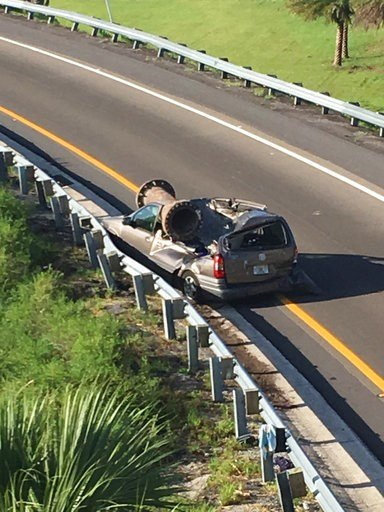 (Florida Highway Patrol via AP). In this photo provided by the Florida Highway Patrol, a van is shown with a piece of scrap metal on its roof  in Orange County, Florida, on Saturday, July 15, 2017. The highway patrol said the scrap metal fell from a tr...