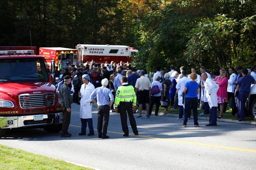 (Charles Hatcher/The Valley News via AP). First responders, doctors, staff, patients, their family members and others wait near the main entrance of Dartmouth Hitchock Medical Center during an active shooter incident on Tuesday, Sept. 12, 2017, at the ...