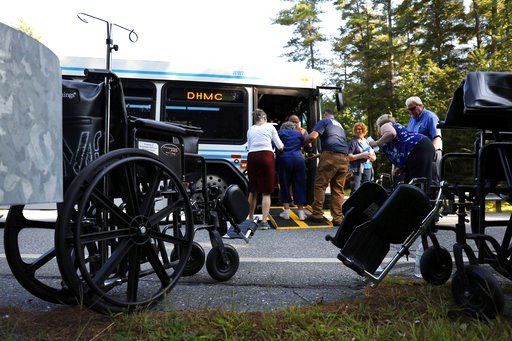 (Charles Hatcher/The Valley News via AP). First responders and Dartmouth Hitchock Medical Center staff help a patient onto an evacuating bus during an active shooter incident on Tuesday, Sept. 12, 2017, at the medical center in Lebanon, N.H. A family m...