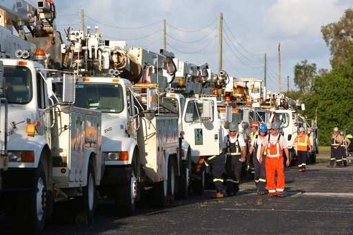 (Scott Keeler/Tampa Bay Times via AP). Power trucks and workers head out from Derby Lane, in St. Petersburg, Fla., Tuesday, Sept. 12, 2017, into Pinellas County to restore power after Hurricane Irma. More than 1 million Georgia Power and Electric Membe...