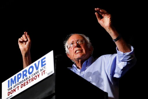 "(AP Photo/John Minchillo). In this July 9, 2017 photo, Sen. Bernie Sanders, I-Vt., speaks during a ""Care Not Cuts"" rally in support of the Affordable Care Act in Covington, Ky.  House Minority Leader Nancy Pelosi is declining to endorse Sen. Bernie San..."