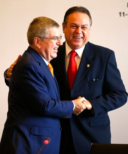 (AP Photo/Martin Mejia). International Olympic Committee President Thomas Bach, left, embraces Pedro del Rosario, president of Peru's Olympic Committee, at the opening IOC session in Lima, Peru, Monday, Sept. 11, 2017. Bach is in Lima for the Wednesday...