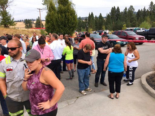 (Dan Pelle/The Spokesman-Review via AP). Parents gather in the parking lot behind Freeman High School in Rockford, Wash. to wait for their kids, after a deadly shooting at the high school Wednesday, Sept. 13, 2017.