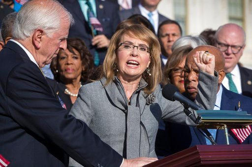 (AP Photo/J. Scott Applewhite). Former Rep. Gabby Giffords of Arizona who survived an assassination attempt in 2011, flanked by Rep. Mike Thompson, D-Calif., left, and Rep. John Lewis, D-Ga., right, joins House Democrats in a call for action on gun saf...