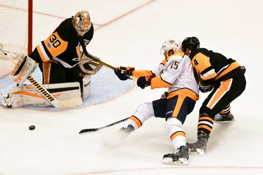 (AP Photo/Keith Srakocic). Nashville Predators' Craig Smith (15) loses the puck while skating in on Pittsburgh Penguins goalie Matt Murray as Justin Schultz (4) defends in the first period of the NHL hockey game, Saturday, Oct. 7, 2017, in Pittsburgh.