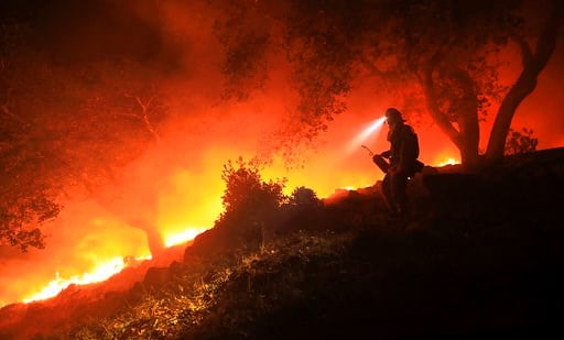 (Kent Porter/The Press Democrat via AP). A San Diego Cal Fire firefighter monitors a flare up on a the head of a wildfire (the Southern LNU Complex), off of High Road above the Sonoma Valley, Wednesday Oct. 11, 2017, in Sonoma, Calif. A wind shift caus...