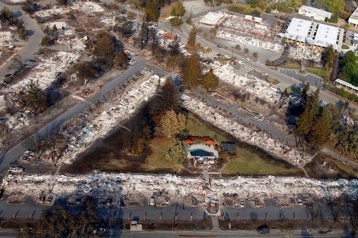 (Karl Mondon /San Jose Mercury News via AP). Burned by the Tubbs fire, only a pool remains among the ashes of an Old Redwood Highway complex near Mark West Springs Road, Wednesday, Oct. 11, 2017, in Santa Rosa, California.