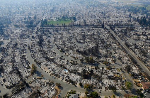 (AP Photo/Jeff Chiu). Homes burned by a wildfire are seen Wednesday, Oct. 11, 2017, in Santa Rosa, Calif. Wildfires whipped by powerful winds swept through Northern California sending residents on a headlong flight to safety through smoke and flames as...