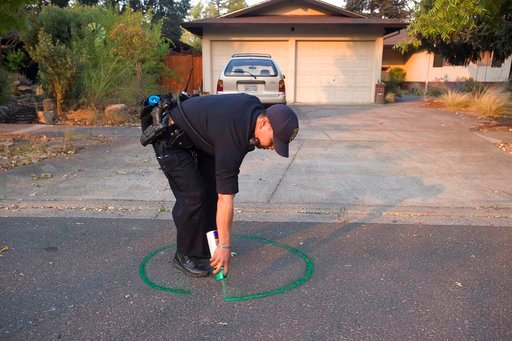 (Paul Kitagaki Jr./The Sacramento Bee via AP). Oakland Police officer Anh Nguyen spray paints the street to mark that a house in Calistoga, Calif., is vacant on Wednesday, Oct. 11, 2017. The entire historic town of Calistoga, population 5,000, was evac...