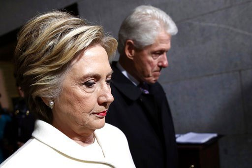 (Win McNamee/Pool Photo via AP, File). FILE - In this Jan. 20, 2017, file photo, former Sen. Hillary Clinton and former President Bill Clinton arrive on the West Front of the U.S. Capitol on Friday, Jan. 20, 2017, in Washington, for the inauguration ce...