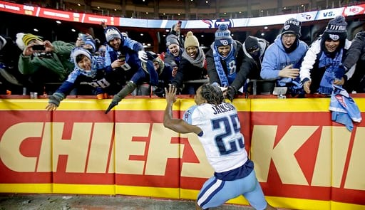 (AP Photo/Charlie Riedel). Tennessee Titans cornerback Adoree' Jackson celebrates with fans after an NFL wild-card playoff football game against the Kansas City Chiefs, Saturday, Jan. 6, 2018, in Kansas City, Mo.