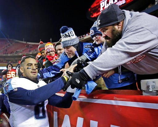 (AP Photo/Charlie Riedel). Tennessee Titans quarterback Marcus Mariota celebrates with fans after the team's NFL wild-card playoff football game against the Kansas City Chiefs on Saturday, Jan. 6, 2018, in Kansas City, Mo. The Titans won 22-21.