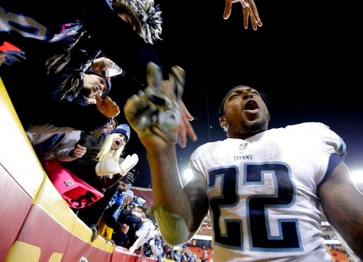 (AP Photo/Charlie Riedel). Tennessee Titans running back Derrick Henry celebrates with fans after the team's NFL wild-card playoff football game against the Kansas City Chiefs on Saturday, Jan. 6, 2018, in Kansas City, Mo. The Titans won 22-21.