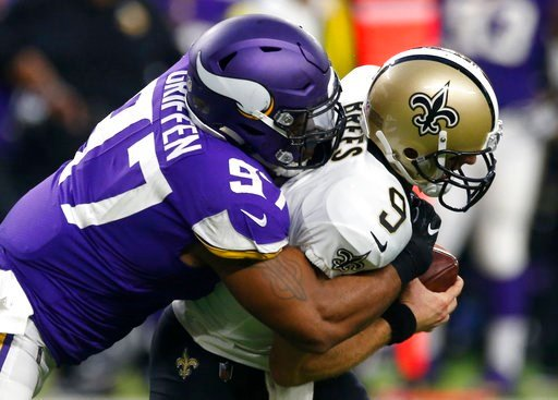 (AP Photo/Jim Mone, File). FILE - In this Sept. 11, 2017, file photo, New Orleans Saints quarterback Drew Brees (9) is sacked by Minnesota Vikings defensive end Everson Griffen (97) during the first half of an NFL football game in Minneapolis. The Viki...