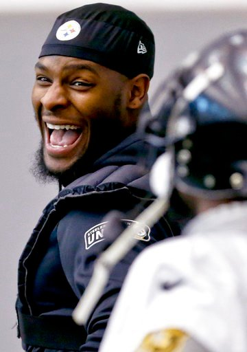 (AP Photo/Keith Srakocic). Pittsburgh Steelers running back Le'Veon Bell (26), left, has a laugh with running back Stevan Ridley during an NFL football practice, Thursday, Jan. 11, 2018, in Pittsburgh. The Steelers host the Jacksonville Jaguars in a di...