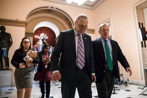 (AP Photo/J. Scott Applewhite). Senate Minority Leader Chuck Schumer, D-N.Y., left, walks with Sen. Dick Durbin, D-Ill., the minority whip, as lawmakers continue negotiating on a deal that would include a fix for the Deferred Action for Childhood Arriv...