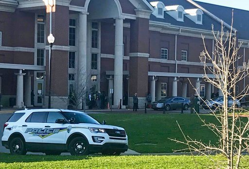 (Carol Robinson/AL.com via AP). Authorities investigate the scene where a shooting occurred at Huffman High School, Wednesday, March 7, 2018, in Birmingham, Ala. Birmingham Interim Police Chief Orlando Wilson said at a news conference that authorities ...