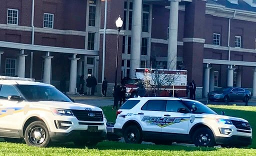 (Carol Robinson/AL.com via AP). Authorities investigate the scene where a shooting occurred at Huffman High School, Wednesday, March 7, 2018, in Birmingham, Ala. Police say at least one 17-year-old girl has been killed in a shooting at dismissal time W...
