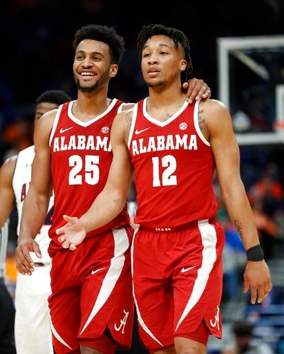 (AP Photo/Jeff Roberson). Alabama's Braxton Key (25) and Dazon Ingram (12) celebrate during the second half in an NCAA college basketball quarterfinal game against Auburn at the Southeastern Conference tournament Friday, March 9, 2018, in St. Louis. Al...