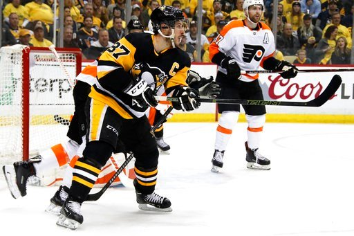 (AP Photo/Gene J. Puskar). Pittsburgh Penguins' Sidney Crosby (87) redirects a shot past Philadelphia Flyers goaltender Brian Elliott for a goal during the second period in Game 1 of an NHL first-round hockey playoff series in Pittsburgh, Wednesday, Ap...