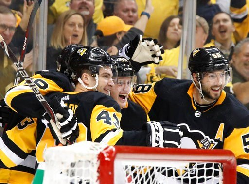 (AP Photo/Gene J. Puskar). Pittsburgh Penguins' Jake Guentzel, center, celebrates his goal with teammates during the second period in Game 1 of an NHL first-round hockey playoff series against the Philadelphia Flyers in Pittsburgh, Wednesday, April 11,...