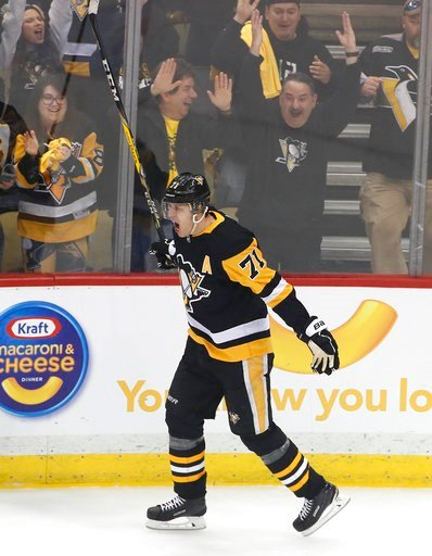 (AP Photo/Gene J. Puskar). Pittsburgh Penguins' Evgeni Malkin celebrates his goal during the period in Game 1 of an NHL first-round hockey playoff series against the Philadelphia Flyers in Pittsburgh, Wednesday, April 11, 2018.