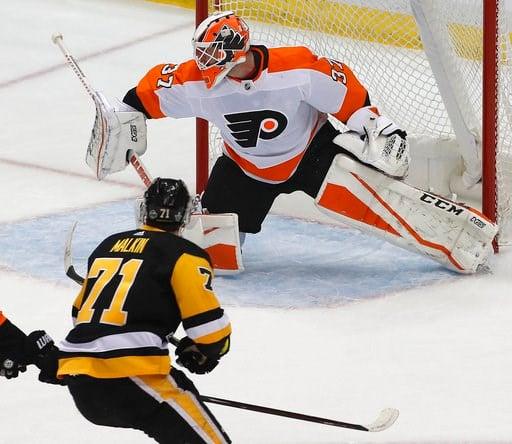 (AP Photo/Gene J. Puskar). Pittsburgh Penguins' Evgeni Malkin (71) gets a shot behind Philadelphia Flyers goaltender Brian Elliott (37) for a goal during the first period in Game 1 of an NHL first-round hockey playoff series against the Philadelphia Fl...