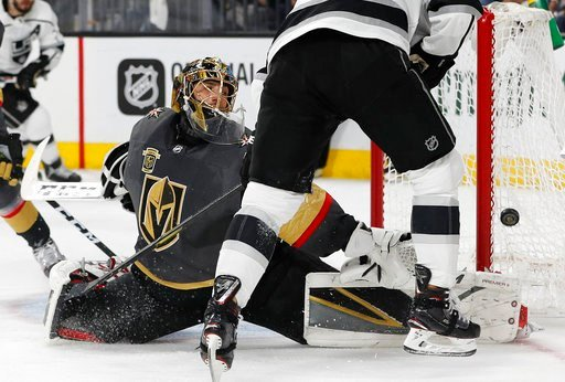 (AP Photo/John Locher). Vegas Golden Knights goaltender Marc-Andre Fleury blocks a shot next to Los Angeles Kings left wing Tanner Pearson during the third period of Game 1 of an NHL hockey first-round playoff series, Wednesday, April 11, 2018, in Las ...