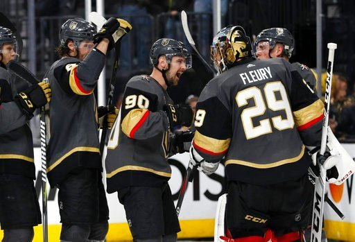 (AP Photo/John Locher). The Vegas Golden Knights celebrate after defeating Los Angeles Kings 1-0 in Game 1 of an NHL hockey first-round playoff series Wednesday, April 11, 2018, in Las Vegas.