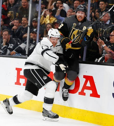 (AP Photo/John Locher). Los Angeles Kings defenseman Dion Phaneuf (3) checks Vegas Golden Knights left wing James Neal against the boards during the second period of Game 1 of an NHL hockey first-round playoff series Wednesday, April 11, 2018, in Las V...