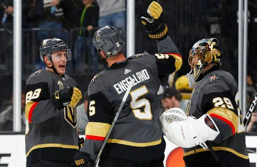 (AP Photo/John Locher). Vegas Golden Knights defenseman Nate Schmidt, defenseman Deryk Engelland and goaltender Marc-Andre Fleury, from left, celebrate the team's 201 win over the Los Angeles Kings in Game 1 of an NHL hockey first-round playoff series ...