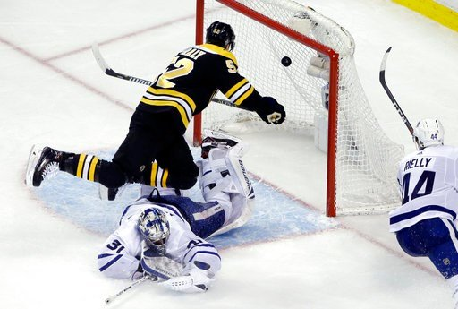 (AP Photo/Elise Amendola). Boston Bruins center Sean Kuraly (52) scores against Toronto Maple Leafs goaltender Frederik Andersen (31) during the third period of Game 1 of an NHL hockey first-round playoff series Thursday, April 12, 2018, in Boston.