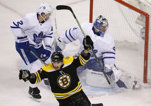 (AP Photo/Elise Amendola). Boston Bruins left wing Brad Marchand (63) celebrates his goal against Toronto Maple Leafs goaltender Frederik Andersen (31) as Maple Leafs defenseman Ron Hainsey (2) looks at the goal during the first period of Game 1 of an ...