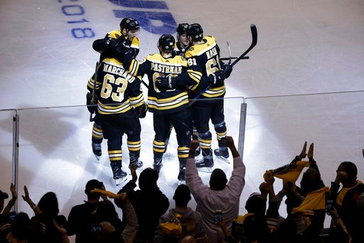 (AP Photo/Elise Amendola). Boston Bruins left wing Brad Marchand (63) celebrates his goal with teammates during the first period of Game 1 of the team's NHL hockey first-round playoff series against the Toronto Maple Leafs, Thursday, April 12, 2018, in...