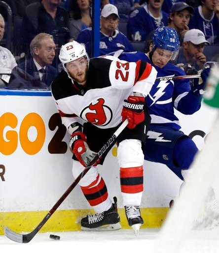 (AP Photo/Chris O'Meara). New Jersey Devils right wing Stefan Noesen (23) eludes a check by Tampa Bay Lightning defenseman Mikhail Sergachev (98) during the first period of Game 1 of an NHL first-round hockey playoff series Thursday, April 12, 2018, in...