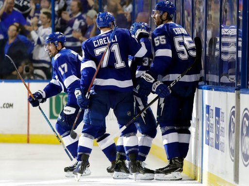 (AP Photo/Chris O'Meara). Tampa Bay Lightning left wing Alex Killorn (17) celebrates his goal against the New Jersey Devils with teammates, including Anthony Cirelli (71) and Braydon Coburn (55), during the third period of Game 1 of an NHL first-round ...