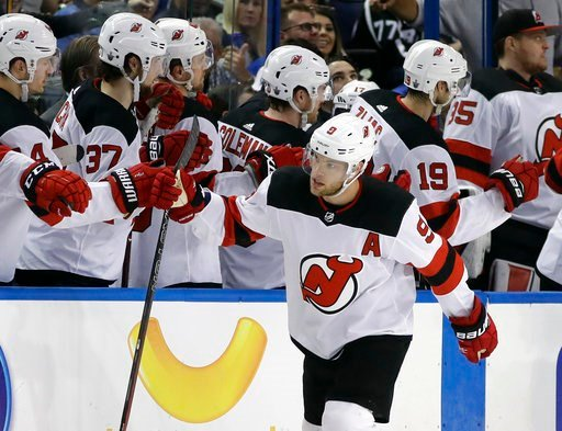 (AP Photo/Chris O'Meara). New Jersey Devils left wing Taylor Hall (9) celebrates with the bench after his goal against the Tampa Bay Lightning during the second period of Game 1 of an NHL first-round hockey playoff series Thursday, April 12, 2018, in T...
