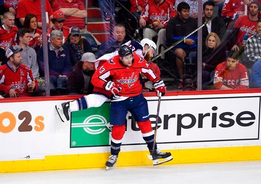 (AP Photo/Nick Wass). Washington Capitals right wing Tom Wilson (43) checks Columbus Blue Jackets defenseman Ian Cole (23) against the boards during the third period in Game 1 of an NHL first-round hockey playoff series, Thursday, April 12, 2018, in Wa...