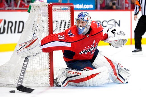 (AP Photo/Nick Wass). Washington Capitals goaltender Philipp Grubauer reaches for the puck during the second period in Game 1 of an NHL first-round hockey playoff series against the Columbus Blue Jackets, Thursday, April 12, 2018, in Washington.
