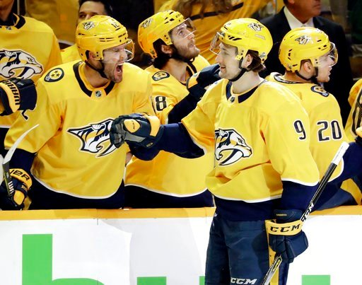 (AP Photo/Mark Humphrey). Nashville Predators left wing Filip Forsberg (9), of Sweden, is congratulated by Mike Fisher, left, after Forsberg scored a goal against the Colorado Avalanche during the third period in Game 1 of an NHL hockey first-round pla...