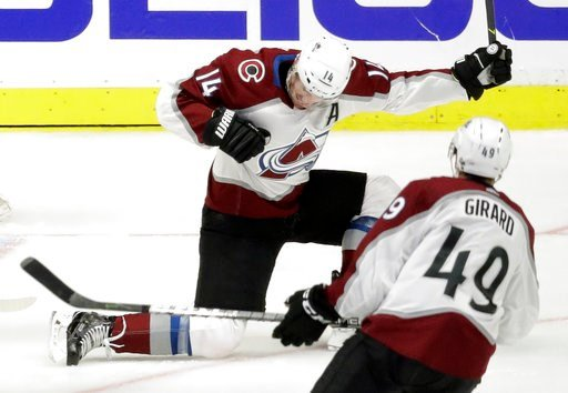 (AP Photo/Mark Humphrey). Colorado Avalanche left wing Blake Comeau (14) celebrates after scoring a goal against the Nashville Predators during the second period in Game 1 of an NHL hockey first-round playoff series Thursday, April 12, 2018, in Nashvil...