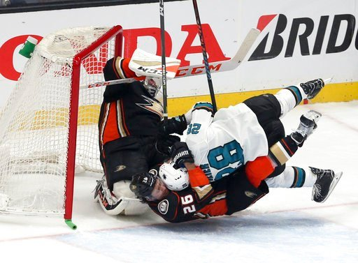 (AP Photo/Reed Saxon). San Jose Sharks right winger Timo Leier (28) tangles with Anaheim Ducks defenseman Brandon Montour (26) and goalie John Gibson (36) during the first period of Game 1 of an NHL hockey first-round playoff series in Anaheim, Calif.,...
